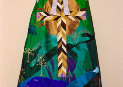 Consecration JC Croneberger, The High Point Monument reimagined as a Chevron cross of the colors of humanity including lavendar triangles stating clearly we are all one in Christ