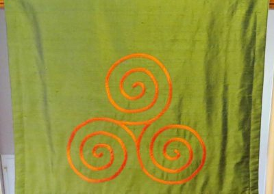 Reverisble altar cloth for the Sophia Roman Catholic Women's church using their logo reversing to a feminine Celtic knot