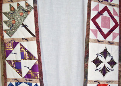This is a personal journey set made for an African American Priest telling her story through quilts