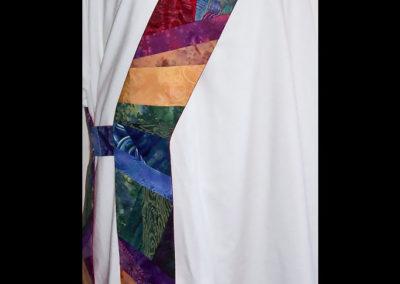 A rainbow crazy quilt featuring animals