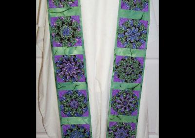 Church window quilt block made of a grape fabric