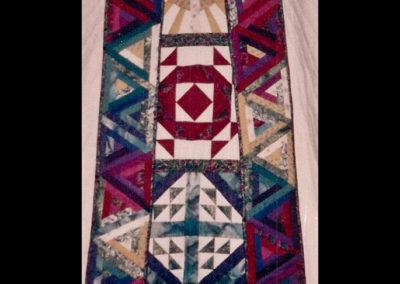 Pyramid log cabin of many colors